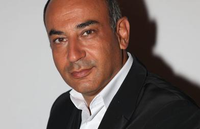 Geroges Djen, director de LivePoker y asociado de Tapie, al teléfono / igamagazine.com